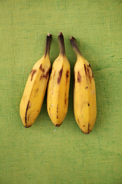 Bunch of banannas isolated on green background