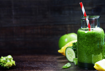 Fresh organic green smoothie - detox, diet and healthy food conc