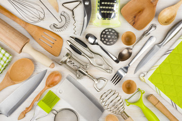 Background of kitchen utensils on wooden kitchen table
