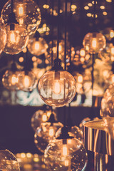 Beautiful luxury interior light bulb and lamp decor. Vintage filter.