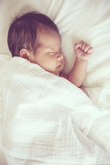 Soft focus and blurry of Carefree sleep little baby, vintage sty