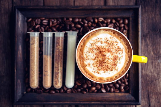 coffee mocha hot and coffee beans on wooden table on brown backg