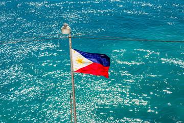 Flag of Philippines Over Aqua Water