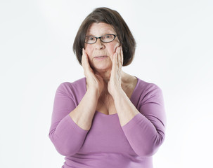 Portrait of a surprised elderly woman..