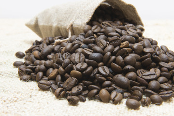 Bag with coffee beans isolated on canvas background