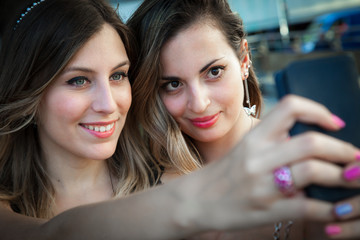 selfie, two young pretty girls make a photo of themselves