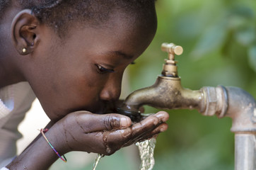 Close-Up of African Child Drinking Water (Drought Water Symbol)