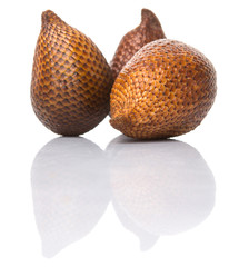 Salak fruit or snake fruits over white background