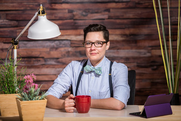 Confident Female in Bowtie with Mug