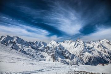 Snowy peaks against the blue sky