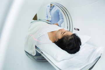 women entering the brain with a Ct scan