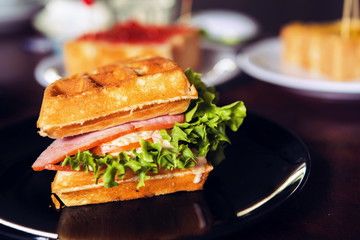 Ham and cheese sandwich served with hot coffee