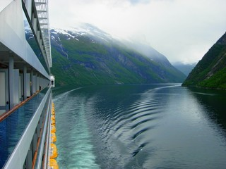 Journey through the Geiranger Fjord in fog on board a cruise ship