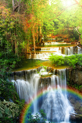 Waterfall in deep forest of Thailand with rainbow.