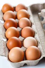 Shot of natural red eggs in retail package. Farm shots.