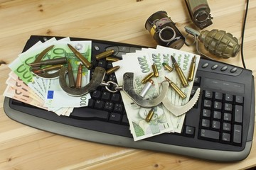 Internet illegal arms trade. Merchant arrest illegal ammunition. Internet crime. Current euro banknotes and Czech koruna.