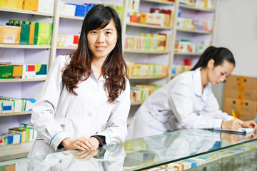 Chinese pharmacy worker in china drugstore
