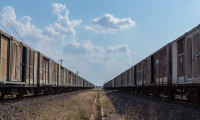 couple of old train with blue sky and cloud