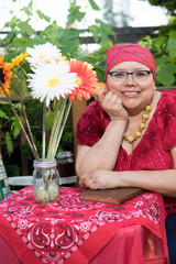 Hispanic Female With Bright Smile Dining Outdoors