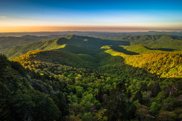 The colorful sunrise of the ancient Blue Ridge Mountains taken during the spring blooms along the scenic Blue Ridge Parkway in North Carolina