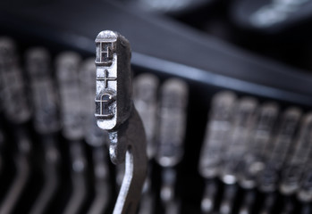 F hammer - old manual typewriter - cold blue filter
