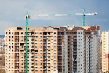 Multistory buildings under construction with cranes