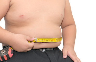 Fat boy measuring his belly with measurement tape isolated