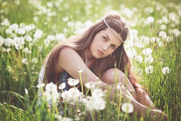 Beautiful free girl in a flower meadow