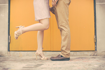 Vintage tone of Male and female legs during a date