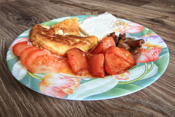 Omelet breakfast snack with cheese and tomatoes