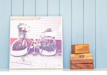Vintage poster and ancient wooden boxes