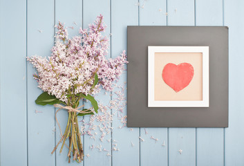 Black wooden frame with red heart and flowers