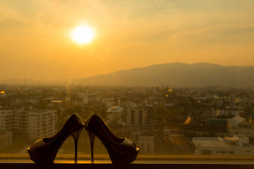 The silhouette bride shoes sunset.