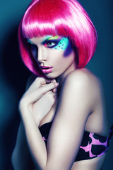woman with colourful make-up and pink hair