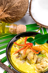 Hot coconut chicken soup with chili and curry