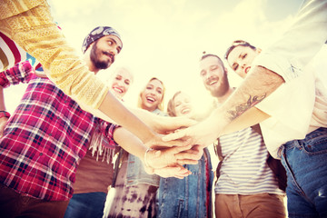Friends Huddle Join Holiday Party Group Concept