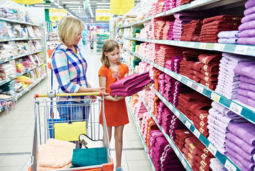 Mother and daughter shopping towels