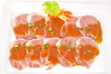 freshness slided pork on white dish for grill