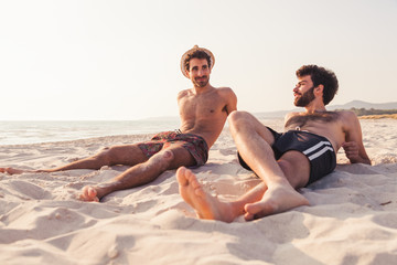 Portrait. Couple of male friends at sunset on the beach on a day of rest summer vacation together, after spending a day of relaxation and fun