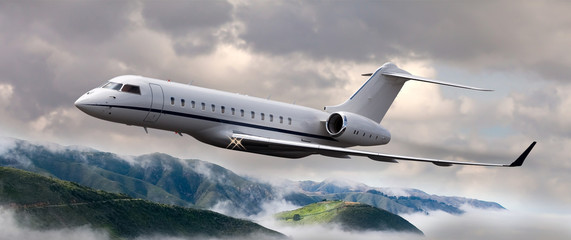 Private jet flying over mountains Wall mural