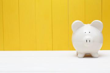 Piggy bank against a yellow wall