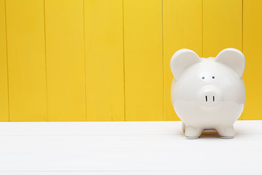 Piggy bank against a yellow wall