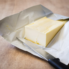 Butter Bar on Wrapping Paper with a Knife