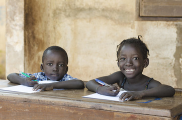 Cute Little Children Learning with Pens Paper in Mali, Africa