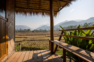 Shelf bungalow and mountainous landscape and paddy field