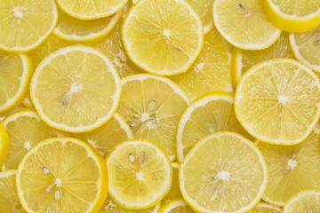 background of sliced ripe lemons organic, pattern