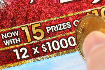 Close up woman scratching lottery ticket called set for life