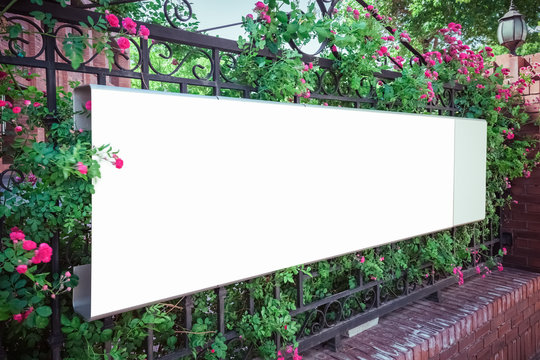 blank billboard on iron fence