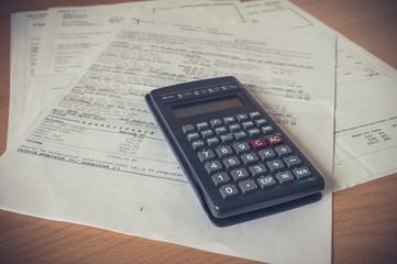 Calculator over a bank financial statement