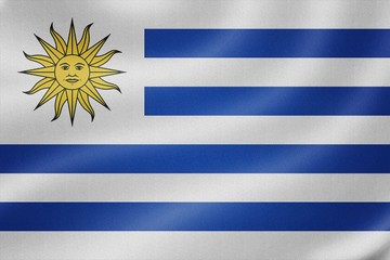 Uruguay flag on the fabric texture background